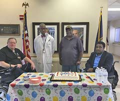 Left to right, Arthur Wolf, Hospital liaison, Dr. Richardson, SCI Chief, Anthony Powell, Vice President and Winston Woodard, III PVA NSO.