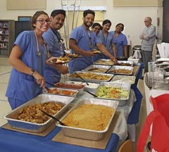 Hospital staff enjoying a meal provided by VPVA